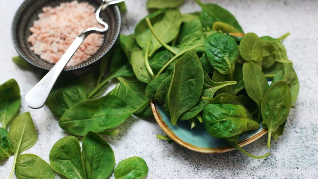spinach leaves with pink salt