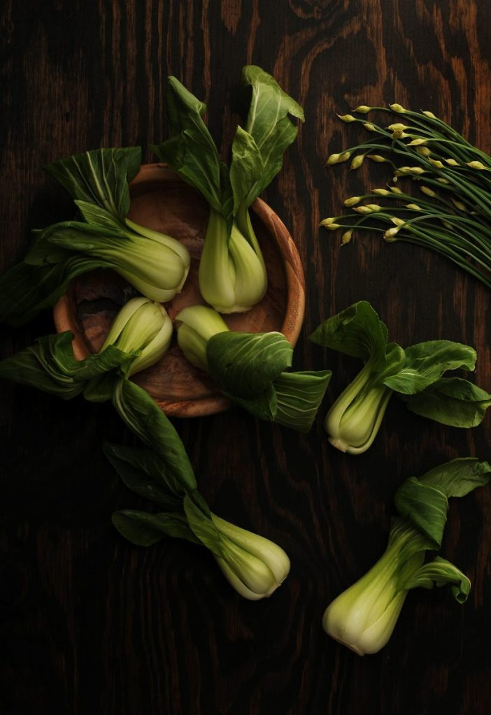 bok choy on brown wooden plate